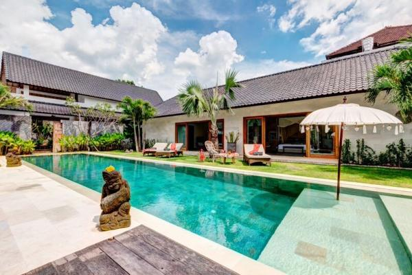 Pool Area By One Of Abaca Villas During Daytime