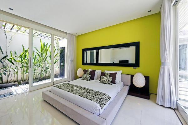 Family Yellow Painted Wall Bedroom With Double Bed