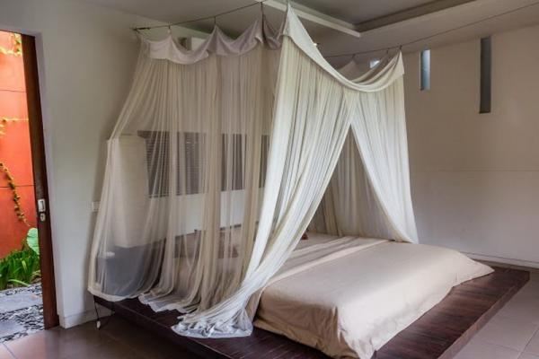 Bed With Mosquito Net In The Bedroom