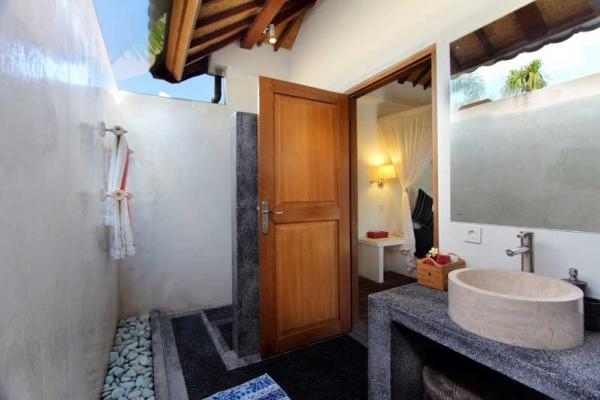 Semi Outdoor Bathroom With Single Sink And Shower