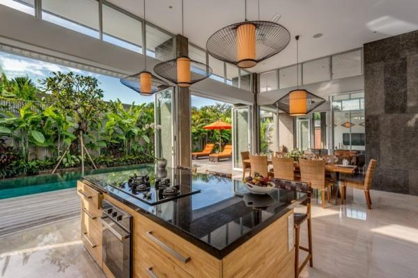 Dining & Kitchen Space Overlooking The Pool