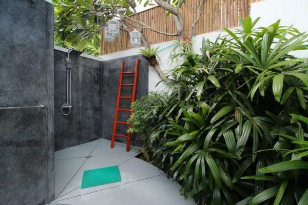 Outdoor Shower Surrounded By Small Garden