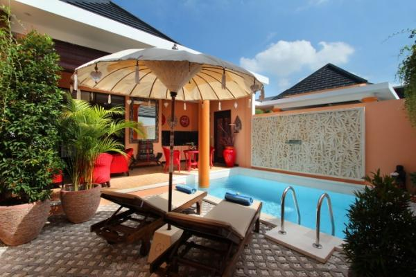 Two Sun Loungers And One Pool Umbrella By The Pool