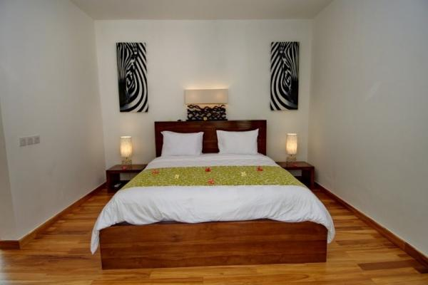 Bedroom 1 With Wooden Floor And Double Size Bed