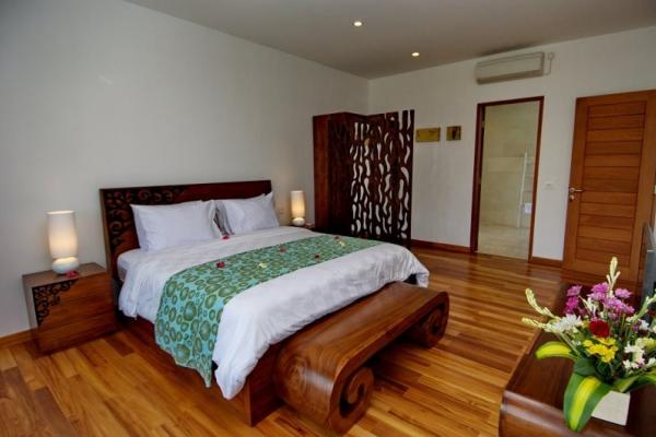 Bedroom 2 With AC Wooden Bed And Flower