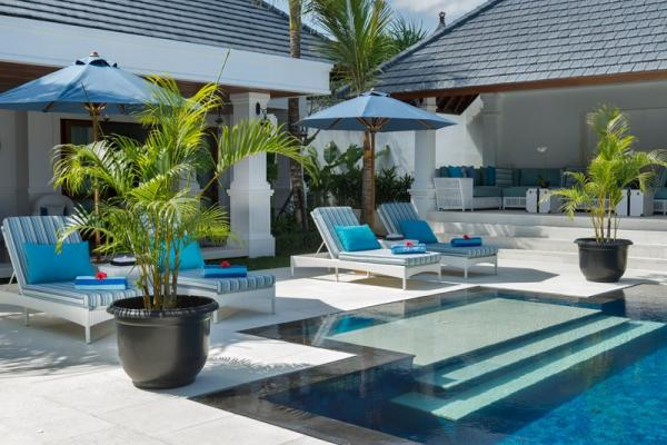 The Pool Side With 4 Sun Loungers And 2 Pool Umbrellas
